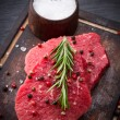 Raw beef steak on wooden table — Stock Photo #55053877