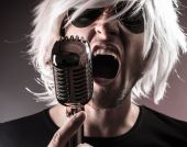 Rock singer with retro microphone — Stock Photo