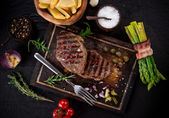 Beef steak on stone table — Stock Photo