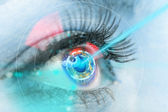 Close-up woman eye with laser medicine. — Stock Photo