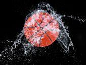 Water splash with sport ball — Stock Photo