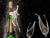 Champagne explosion on black background — Стоковое фото