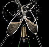 Champagne flutes on black background — Стоковое фото