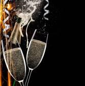 Champagne flutes on black background — Foto Stock