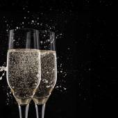 Champagne flutes on black background — Stock Photo