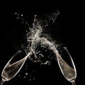 Champagne flutes on black background — Stock Photo