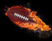 Flying rugby ball with fire flames — Stockfoto