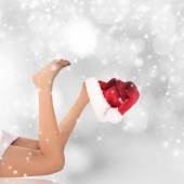 Beautiful woman legs, Christmas background. — Stok fotoğraf