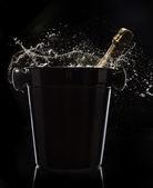 Champagne bucket on black background — Stock Photo