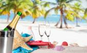 Champagne flutes on sunny beach — Stock Photo