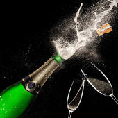Champagne explosion on black background — Stock Photo