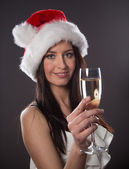 Santa girl with champagne glass — Stock Photo