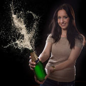 Young brunette woman with champagne glass — Stock Photo