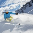 Skier skiing downhill in high mountains — Stock Photo #63562669