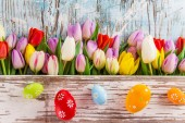 Beautiful bouquet of tulips with easter eggs — Stock Photo
