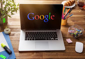 Office workplace with Google screen. — Stock Photo