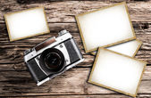 Vintage camera on a wooden background — Stock Photo