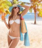 Young sexy brunette in white swimsuit — Stock Photo
