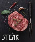 Raw beef steak onblack table — Stock Photo