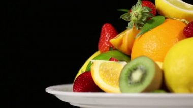 Fresh fruits on black background. — Stock Video