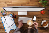 Office workplace with wooden desk. — Stock Photo