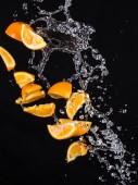 Naranja con salpicaduras de agua — Foto de Stock