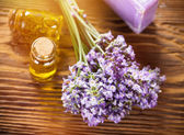 Wellness treatments with lavender flowers on wooden table. — Stock Photo