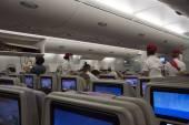 Flight attendants and passengers on board — Stock Photo