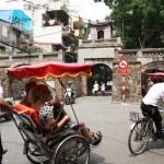 ������, ������: Rickshaws drive tourists in a street of Hanoi