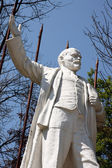 Statue of Lenin in a park — Stock Photo