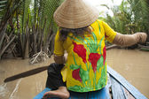 Vietnam woman with a paddle in boat, Mekong River — Stock Photo