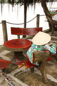 Vietnam woman rests at the bank of Mekong River — Stock Photo