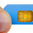 Finger holding sim card — Stock Photo #54365413