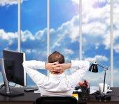 Businessman looking to window — Stock Photo