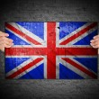 Hand holding flag of United Kingdom — Stock Photo #56860461