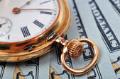 Pocket watch and dollars — Stock Photo