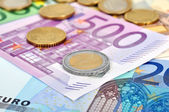Coins and euro banknotes — Stock Photo
