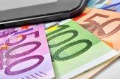 Euro and cellphone — Stockfoto