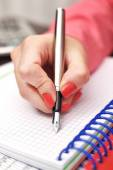 Female hand with ink pen — Stock Photo