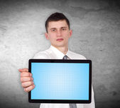 Businessman holding touch pad — Stock Photo