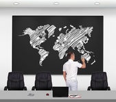 Businessman drawing world map — Stock Photo