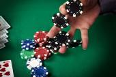 Dealer collects poker chips — Stock Photo