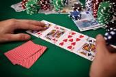 Gambler playing poker cards — Stock Photo
