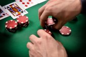 Dealer collects red poker chips — Stock Photo