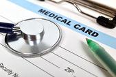 Medical card and stethoscope — ストック写真
