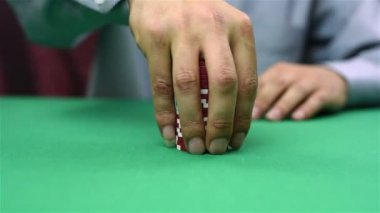 Dealer collects red poker chips — Stock Video