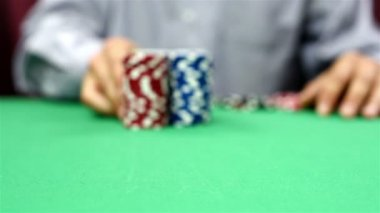 Dealer moves a stack of poker chips — Stock Video