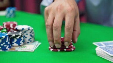 Hand collects red poker chips — Stock Video