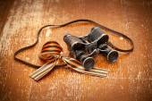 Victory Day on May 9. Vintage military binoculars and George Ribbon — Stock Photo