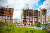 The construction site. Construction of the new building. Construction cranes — Stock Photo